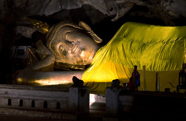 Reclining Buddha statue in the cave