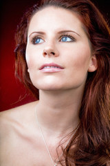 Attractive woman with long red hair.