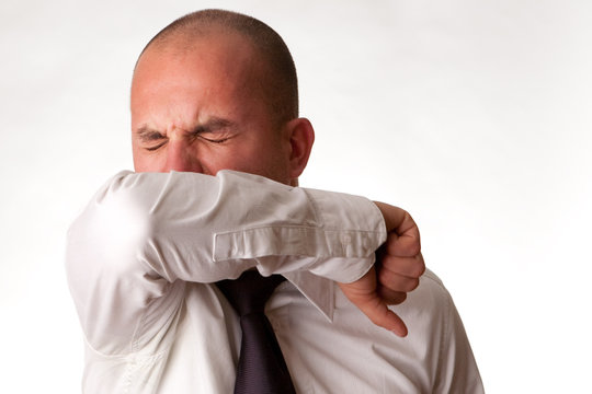 Man Coughing/Sneezing into Arm/Elbow