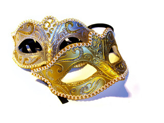 Two masquerade mask on a white surface