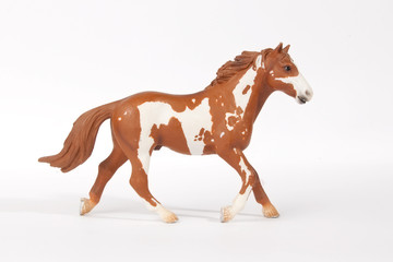 the statuette of a running horse