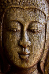 wood craft of lord buddha face on the door of Thai style temple