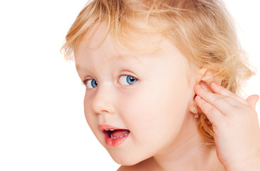 The little girl shows on an ear