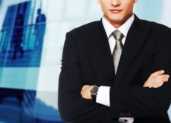 Young businessman against office building