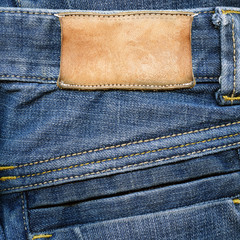 Grungy leather label on jeans