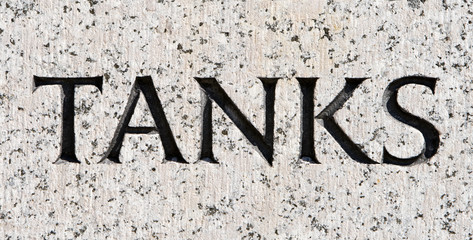 "Word ""Tanks"" Carved in Gray Granite"