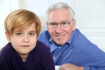 Portrait of little blond boy with grandfather
