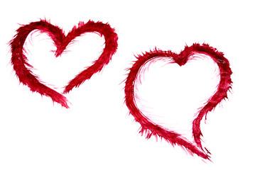 Два красных нарисованных сердца.