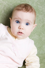 Cute astonished baby