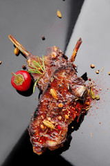 savory plate: grilled ribs over black with spices