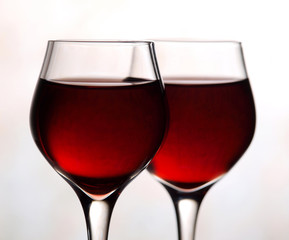 Two red wine glasses on white