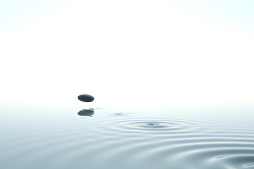 Wall Mural - Zen stone thrown on the water