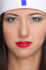 Sexy woman with red lips and medical uniform