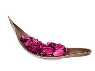 Pink potpourri in wooden decoration