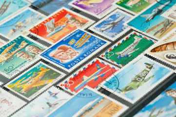collection of aviation themed stamps in an album