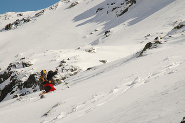 Climber reaching the summit of the Retezat mountains.Romania