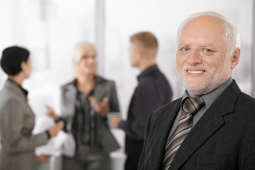 Portrait of senior businessman smiling