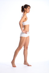 Fit young healthy woman in white sports underwear