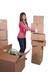 young girl packing up and moving - isolated