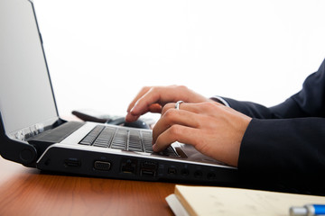 Businessman hands typing on the laptop