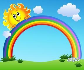 Sun holding rainbow on blue sky