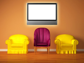 Two yellow chairs with a purple chair and lcd tv