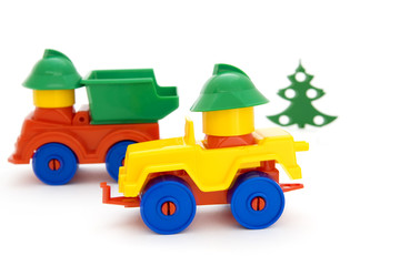 Bright toy cars and tree on a white background