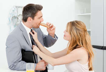 Woman adjusting the tie of her husband