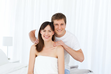 Man giving massage to his wife