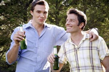 Two men drinking beer