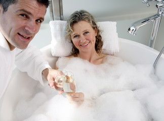 Mature couple having fun in the bathtub