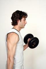 Young man lifting weights