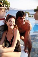 Couple at seaside swimming pool