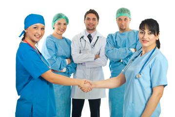 Hospital doctors women handshake