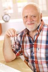 Portrait of happy older man smiling