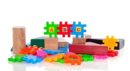 educational colorful plastic and wooden puzzle toy blocks isolat
