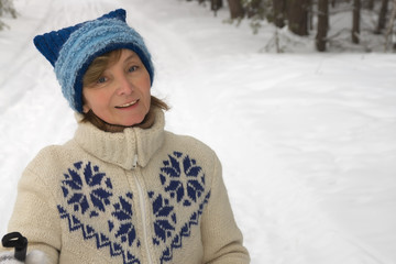 Middle-aged woman smiling with pleasure skiing
