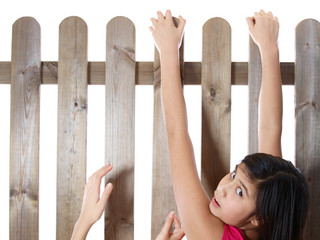 teenage girls climbing over the fence