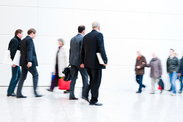 blurred trade fair visitors
