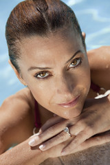 Portrait of a Beautiful Smiling Woman Relaxing In Swimming Pool