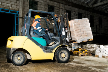 warehouse forklift loader works