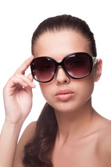 Portrait of beautiful young woman in sunglasses