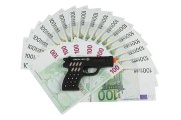Калькулятор в виде пистолета на фоне двойного веера из евро