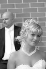 wedding portrait before a brick wall
