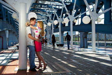 Happy boy and girl on a date on the pedestrian bridge