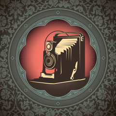 Vintage background with old camera.