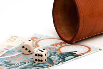 Two dices and some danish money on a white background