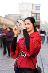 Young woman with headphones, listening to audio guide taking pic