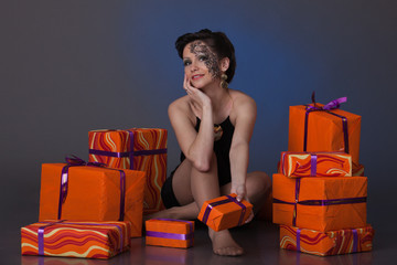 Young woman with gift boxes.