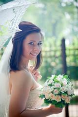 Bride portrait with lacy umbrella